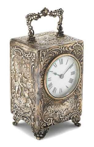 An English silver cased desk clock <BR />William Comynes<BR />London, 1902