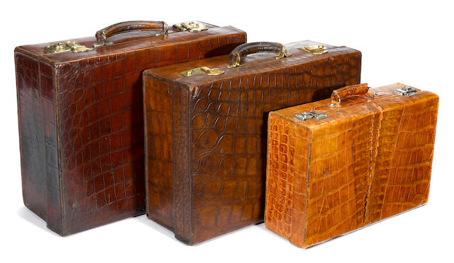 Three crocodile suitcases<BR />second quarter 20th century