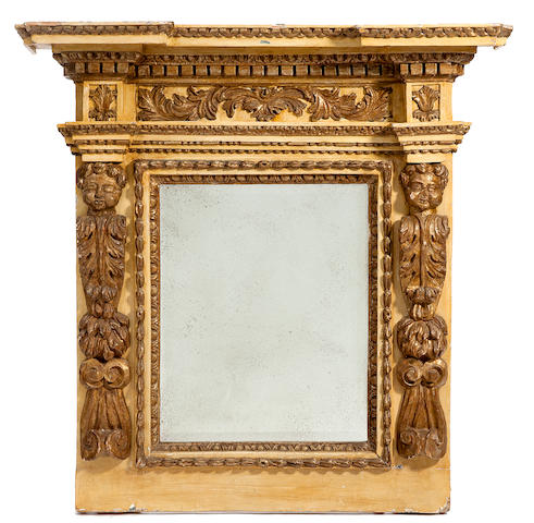 An imposing Italian Baroque parcel gilt paint decorated wall mirror