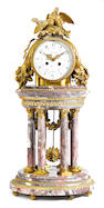 A Louis XVI style gilt bronze mounted marble mantel clock <BR />Lemerle-Charpentier & Cie, Paris, retailed by Boudet <BR />late 19th century
