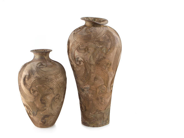 Two similar Contemporary patinated metal urns