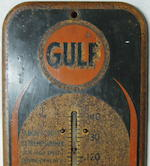 A Gulf Oil thermometer,