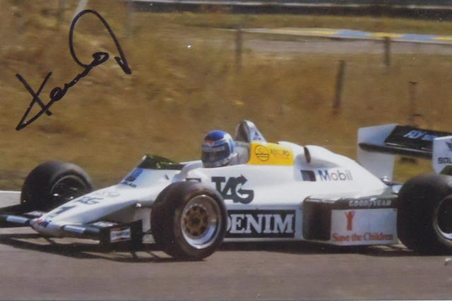 A signed photograph of Keke Rosberg,