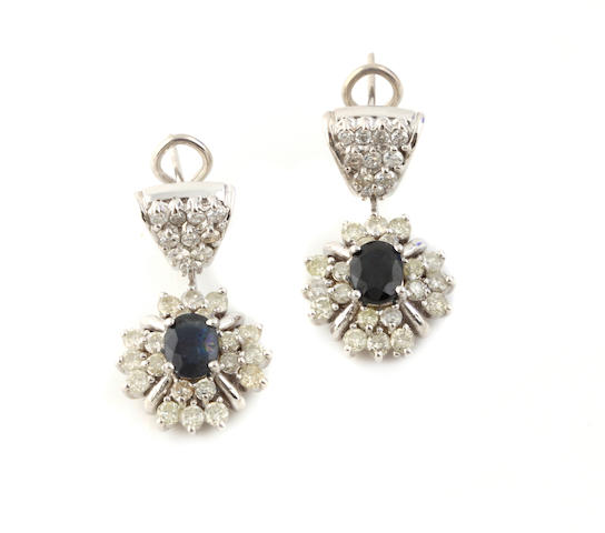 A pair of sapphire, diamond and white gold pendant earrings