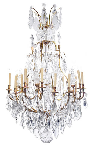 An impressive Louis XV style gilt bronze and cut glass sixteen light chandelier