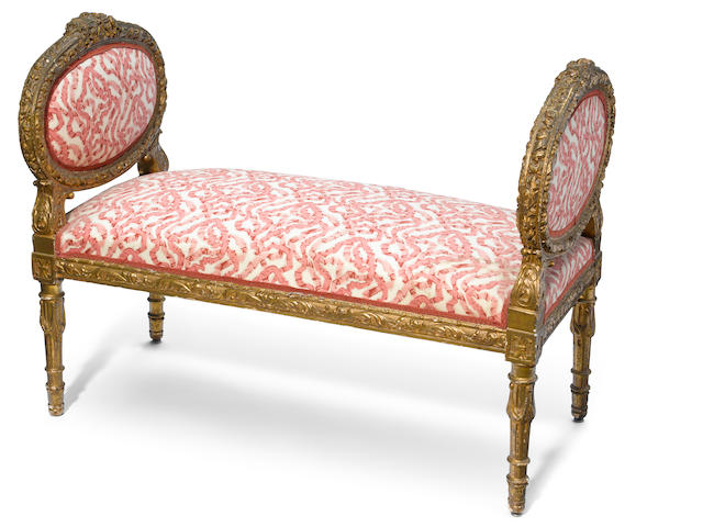 A Louis XVI style carved giltwood window bench <BR />late 19th century