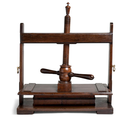 A large oak bookbinder's screw press  19th century height 27in (68.5cm) at lowest setting; width 26in (66cm); depth 15in (38cm)