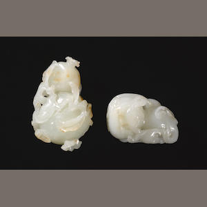 Two carved jade toggles