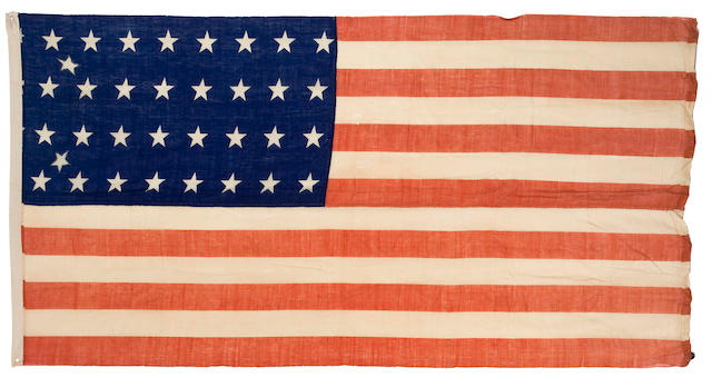 "A Civil War-era United States 32-star flag, 1858-9 With 2 additional stars stitched in for Oregon (1859) and Kansas (1861), the hoist inscribed ""Tucker,"" weights stitched into fly end, so presumably intended for hanging vertically."