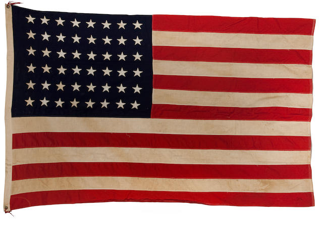 A United States 48-star flag