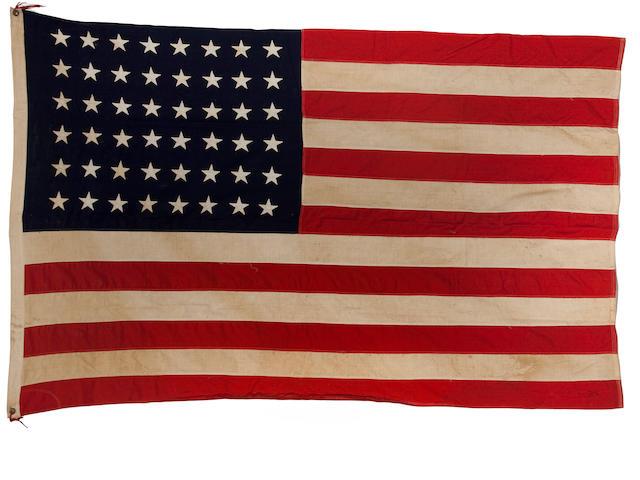 A United States 48-star flag