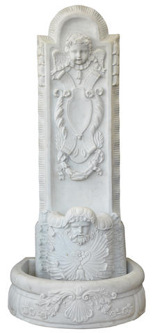 A Baroque style carved marble fountain