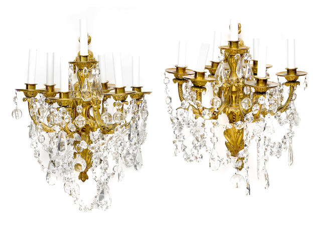 A pair of Louis XVI style gilt bronze and cut glass seven light bras de lumière <BR />late 19th/early 20th century