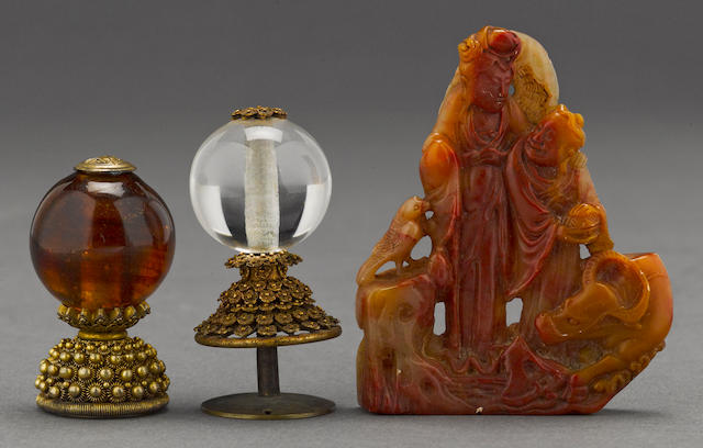 A carved soapstone figural group