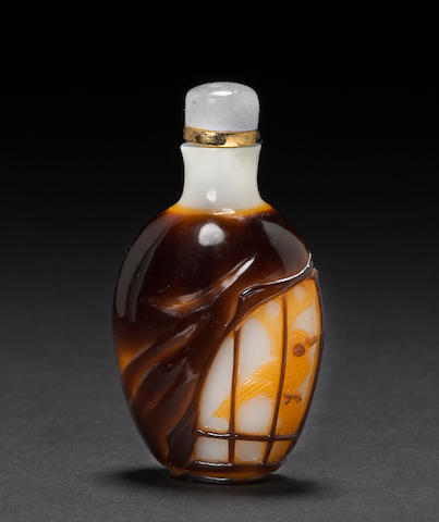 A Peking white glass snuff bottle with two-color overlay Contemporary