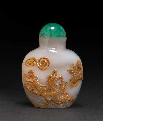 An agate snuff bottle with carved figural decoration