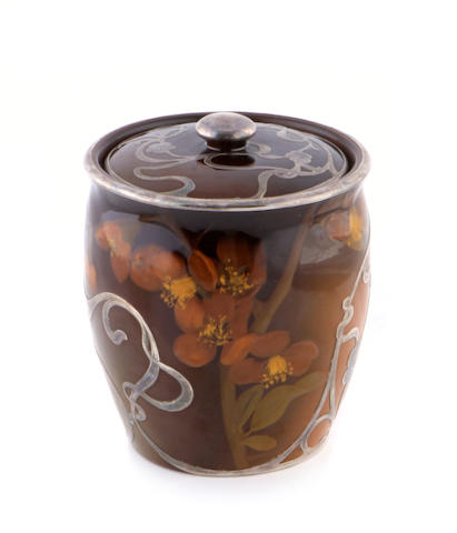 A Rookwood silver overlaid standard glaze earthenware covered jar decorated by Sally Coyne, circa 1898