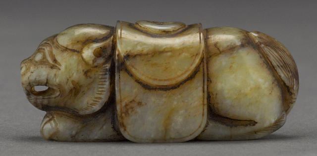 A jade beast-form toggle