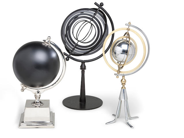 A pair of armillaries and a black slate globe<BR /> Modern, 20th century 20 x 11 in. (50.8 x 27.7 cm.) height x diameter and smaller. 3