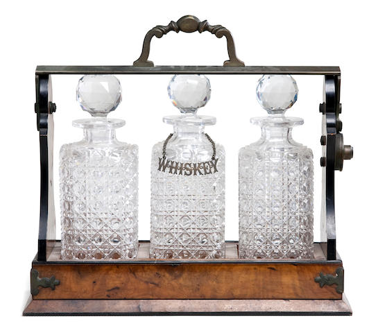 A three decanter tantulus set  13-1/2 x 14-1/2 x 5-3/4 in. (34.2 x 36.8 x 40 cm.) 4