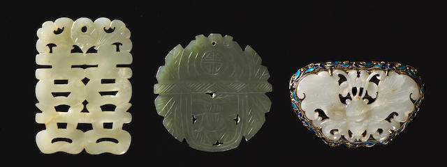 Three carved jade pendants