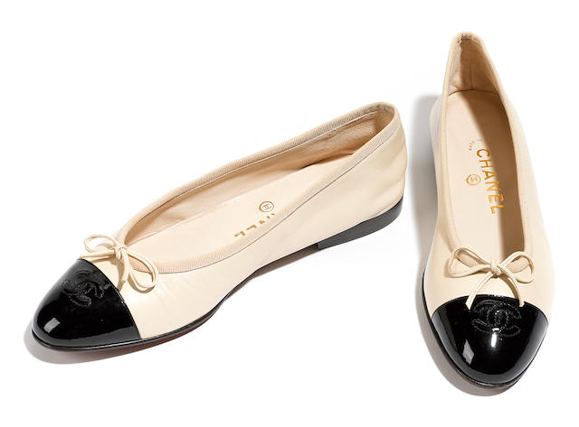 A pair of Chanel embroidered black and beige leather pumps