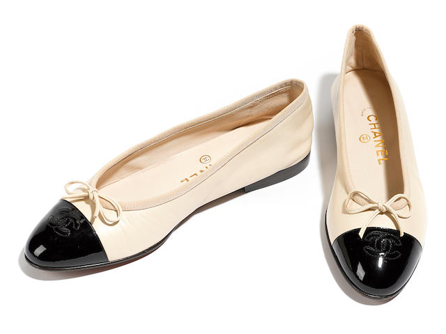 A Chanel black leather with beige embroidered logo pump