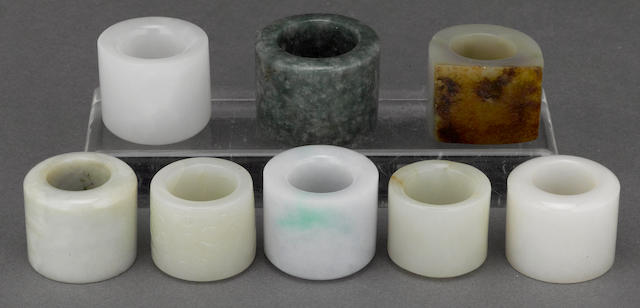 A group of eight jade and hardstone archer's rings