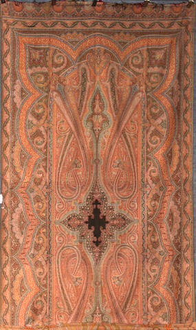 An Indian paisley table covering, now as a wall hanging