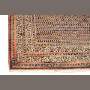 A Persian carpet approximately 11ft. 4in. x 9ft. 8in.