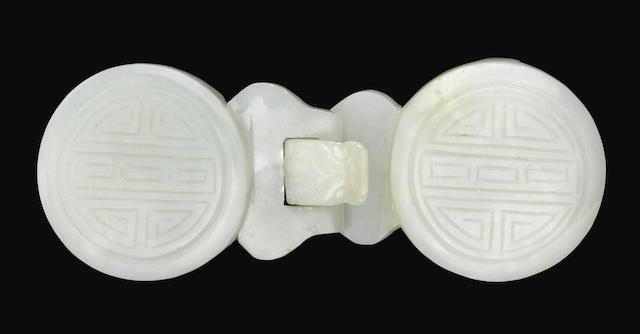 A carved jade belt buckle