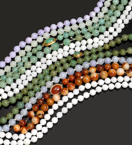 A group of eight jadeite bead necklace strands