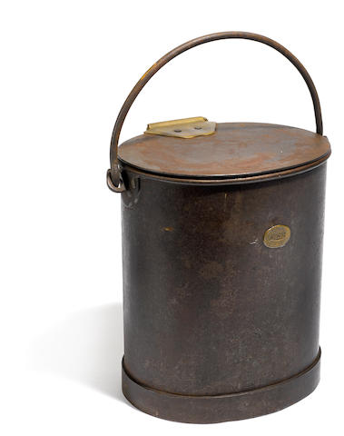 An Edwardian patinated metal and brass coal bin