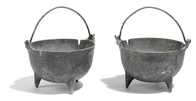 A pair of light metal handled bowls