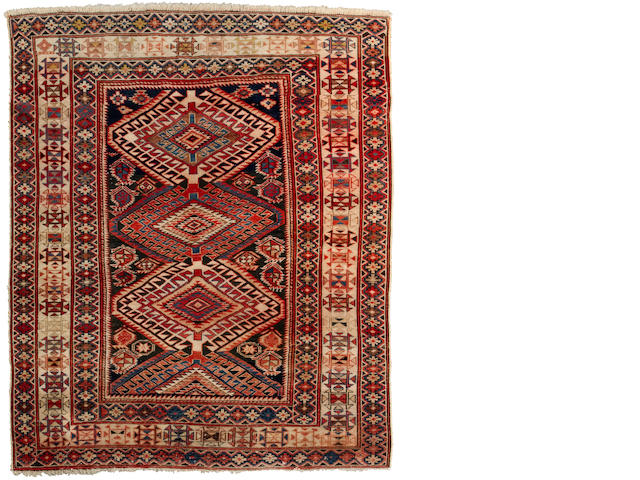 A Shirvan rug<BR />Caucasian, late 19th century approximate size 4ft 1in x 5ft (124.5 x 152.5cm)