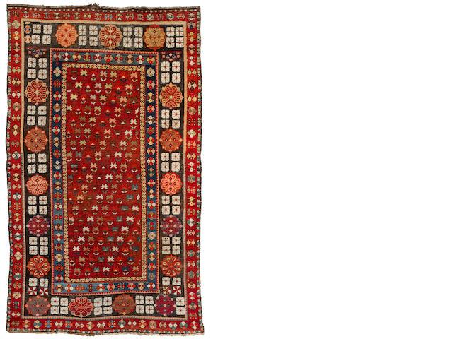 "An oriental rug 6'6"" x 3'8"""