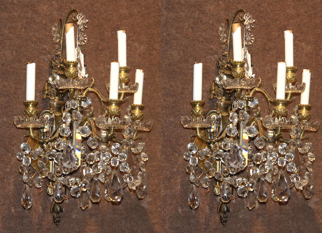 A pair of Louis XVI style gilt bronze and cut glass five light bras de lumière late 20th century