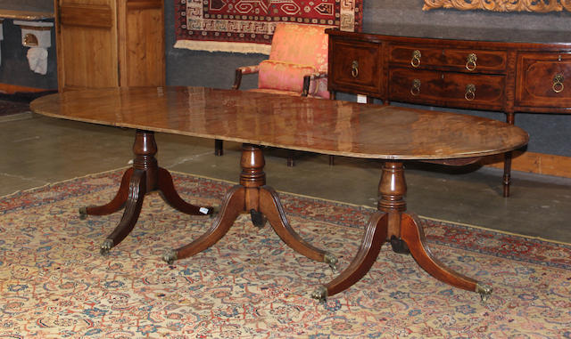 A Regency triple pedestal mahogany dining table first quarter 19th century