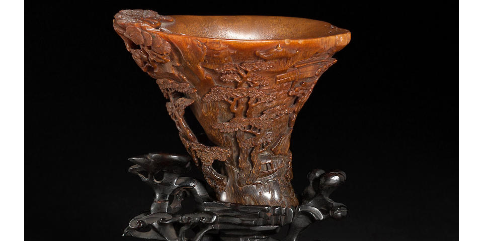 A carved rhinoceros horn libation cup 17th/18th century