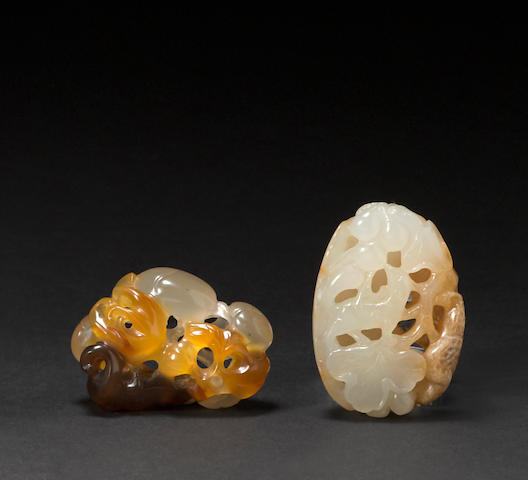 Two small reticulated hardstone pebbles