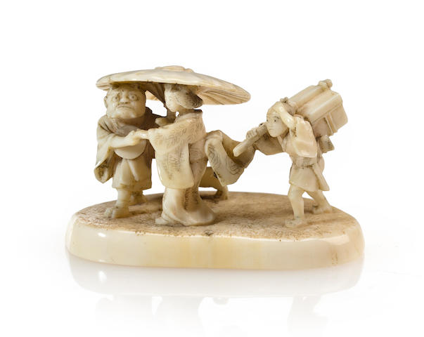 An ivory figural netsuke Late 19th century