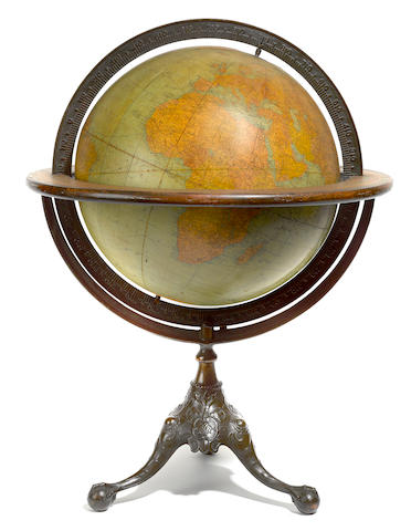 Terrestrial globe on wrought iron tripod stand by Rand McNally and Co.