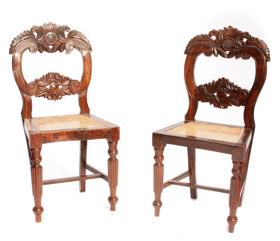 A pair of Anglo Indian carved rosewood chairs