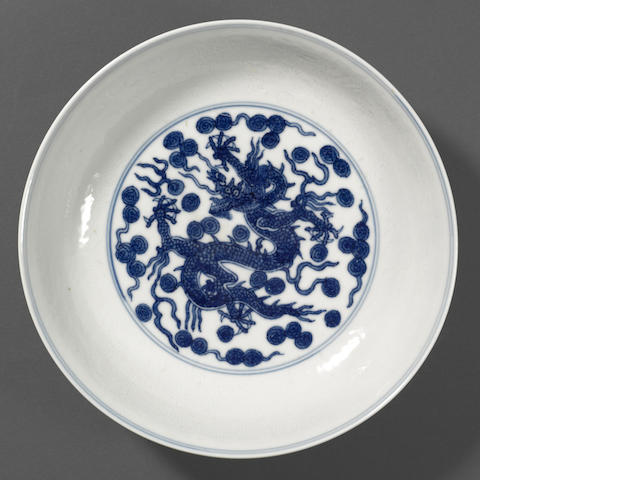 A blue and white porcelain dish with dragon decoration  Jiajing mark and period