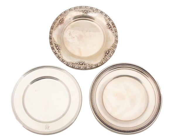 Three sets of American  sterling silver  bread plates 20th century