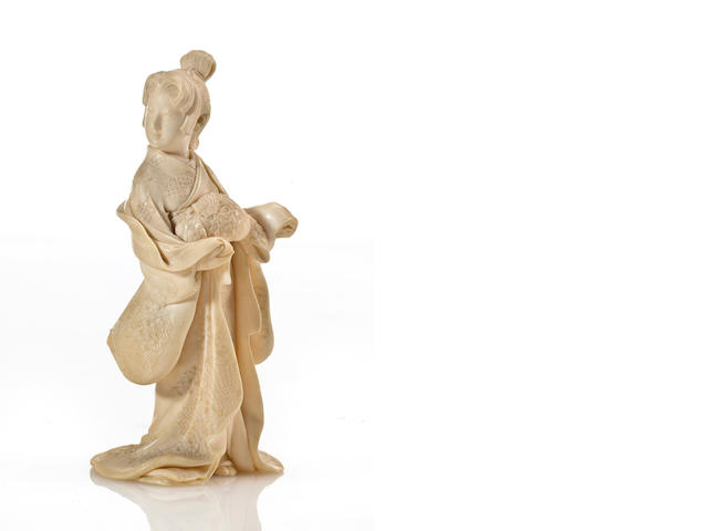 An ivory model of a young beauty in a kimono (very white ivory)
