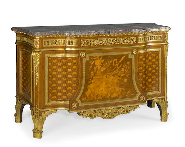 A fine Louis XVI style gilt bronze mounted marquetry commode with fleur des peches marble top<BR />Francois Linke<BR />late 19th century
