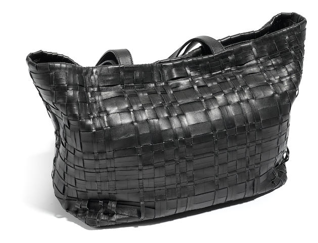 A Prada black leather and suede woven handbag