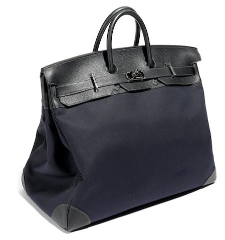 An Hermes large black canvas and leather tote