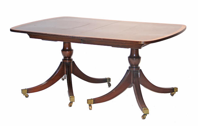 A Regency style mahogany double pedestal dining table 20th century